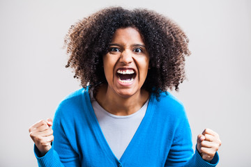 Portrait of furious woman screaming