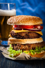 Hamburger on paper with beer