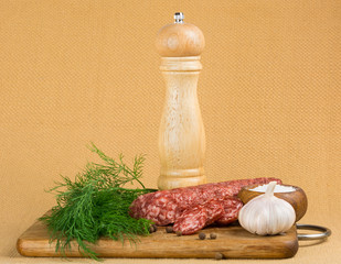 Simple still life with cut sausage