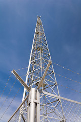 Communications pylon against a blue sky