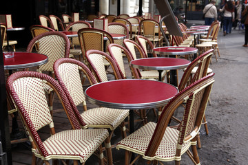 Street view of a coffee terrace with tables and chairs,Paris Fra