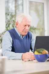 Focused man using laptop