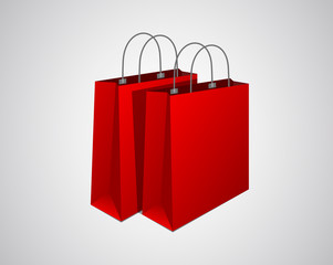 Classic empty red shopping bags composition.