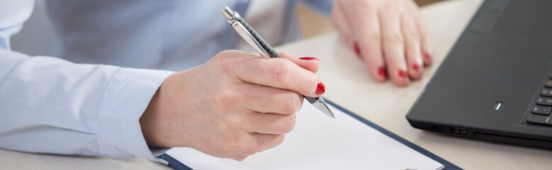 Pen in the hand of businesswoman