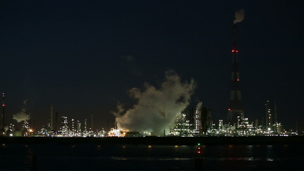 Refinery Behind River At Night
