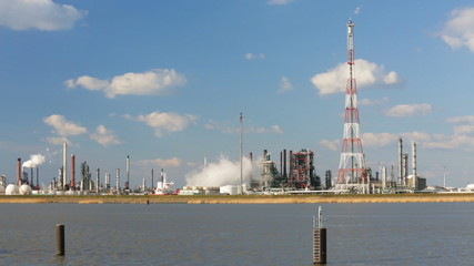 Large Refinery Behind River