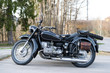 sideview of black oldtimer motorbike with sidecar an leather bag - 81767451