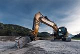 view to huge orange mechanical shovel excavator on gravel