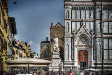 Alighieri statue and Santa Croce cathedral in Florence in tilt s