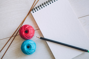 notebook and cotton yarn balls