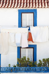 clothesline with clothes in typical house in Ericeira Portugal