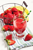 Naklejka Strawberry drink with fresh berries and bananas