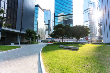 empty pavement and skyscrapers in modern city