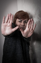 Scared and abused woman with stretched arms