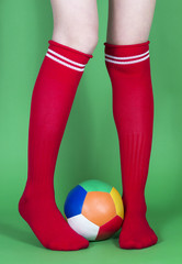 Red socks long legs and football