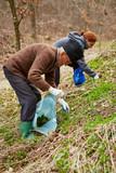 Senior man and her daughter picking nettle leaves