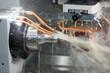 Leinwandbild Motiv Grinding workpiece on cnc grinder machine with cooling emulsion