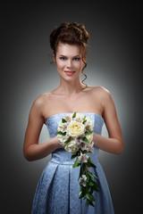 Studio portrait of a beautiful bride in a blue dress