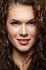 Close-up portrait of beautiful girl with curly hair