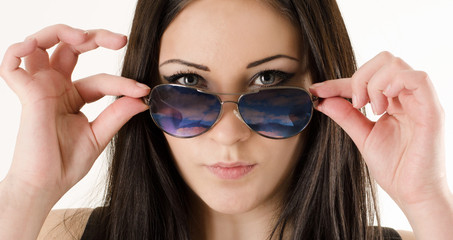 girl looks out of glasses