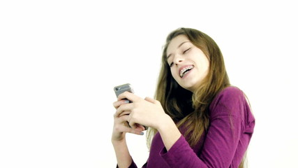 Female teenager playing with cell phone making call