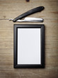 Straight razor and picture frame on wood desk - 81775627