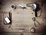 Vintage barber shop equipment on wood background with place for