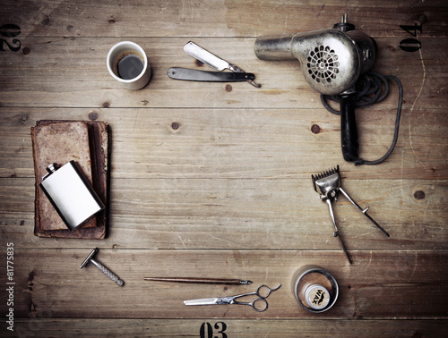 Vintage barber shop equipment on wood background with place for Poster