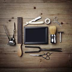 Set of vintage tools of barber shop with black picture frame