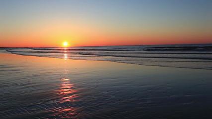 Tranquil beach sunrise