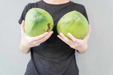 woman breast coconut fruit implant upsize metaphor concept