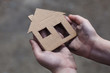 homeless boy holding a cardboard house - 81776411