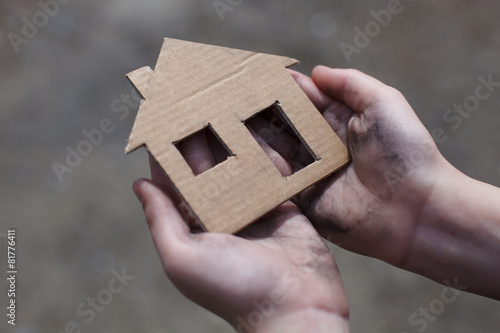 canvas print picture homeless boy holding a cardboard house