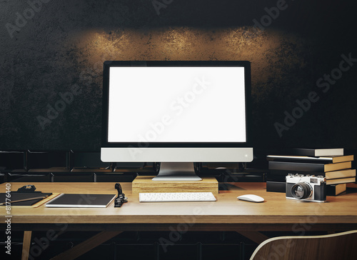 Mock up of generic design computer screen on the table. Workspac - 81776440