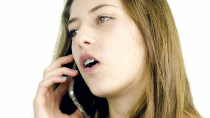Happy teenager talking on the phone isolated closeup
