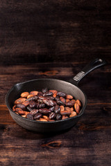 roasted cocoa chocolate beans  in a pan