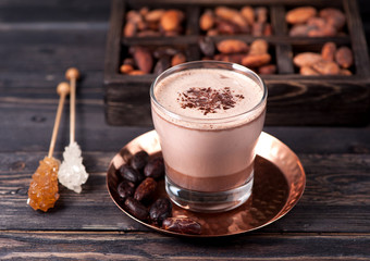 Delicious hot cocoa with chocolate and cocoa beans