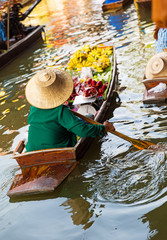 Traditional floating market in Damnoen Saduak
