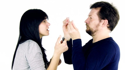 Man breaking cigarette to woman imposing her to quit smoking.
