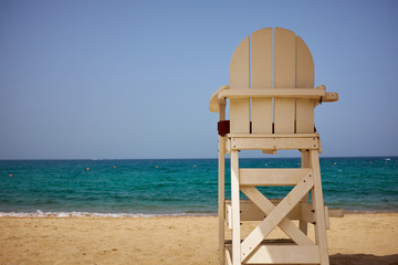 A lifeguard's chair on the beach.