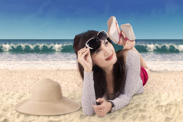 Attractive woman lying on the seaside