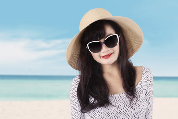 Attractive model with sunglasses at seaside