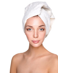 Beautiful woman with a towel on her head