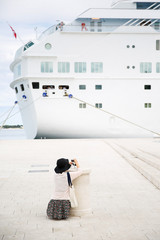 Passenger photographing big cruise ship
