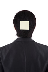 Businessperson attaching note on his head