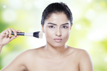 Beauty woman using makeup brush