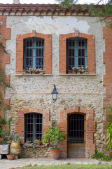 old french house exterior, made by brick, with door