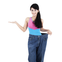 Slim woman with presentation gesture