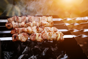 Grilling marinated shashlik