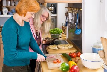 Mom Watching her Other Friend Preparing Food.